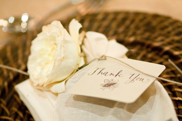Thank you note and wrapped favor