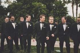 Groom with men in tuxedos and bow ties