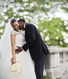 bride in legends romona keveza gown with illusion neckline, groom in jos. a. bank tux kisses neck