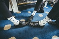 groom and groomsmen show off socks with mustache print