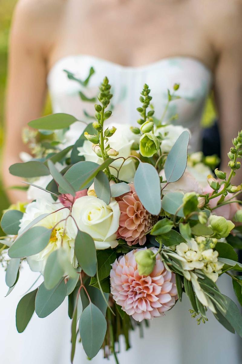 wedding bouquet greenery pink dahlia white rose bride in strapless wedding dress flower design