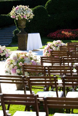 Wood chairs with neutral-toned flower arrangements