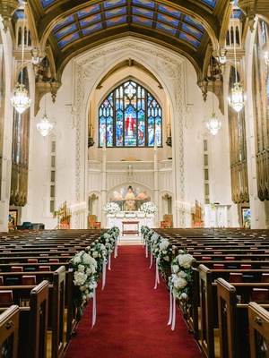 wedding ceremony venue peachtree christian church atlanta stained glass windows pews red aisle