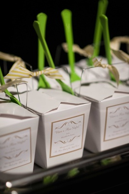 Chinese take out boxes with green spoons filled with rice and chicken at wedding valet