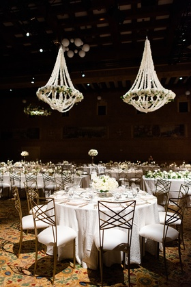 portland art museum wedding reception with chandeliers completely covered in white orchids