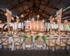 wedding reception head table over dance floor orb pendant twinkle light strands cane vineyard chairs