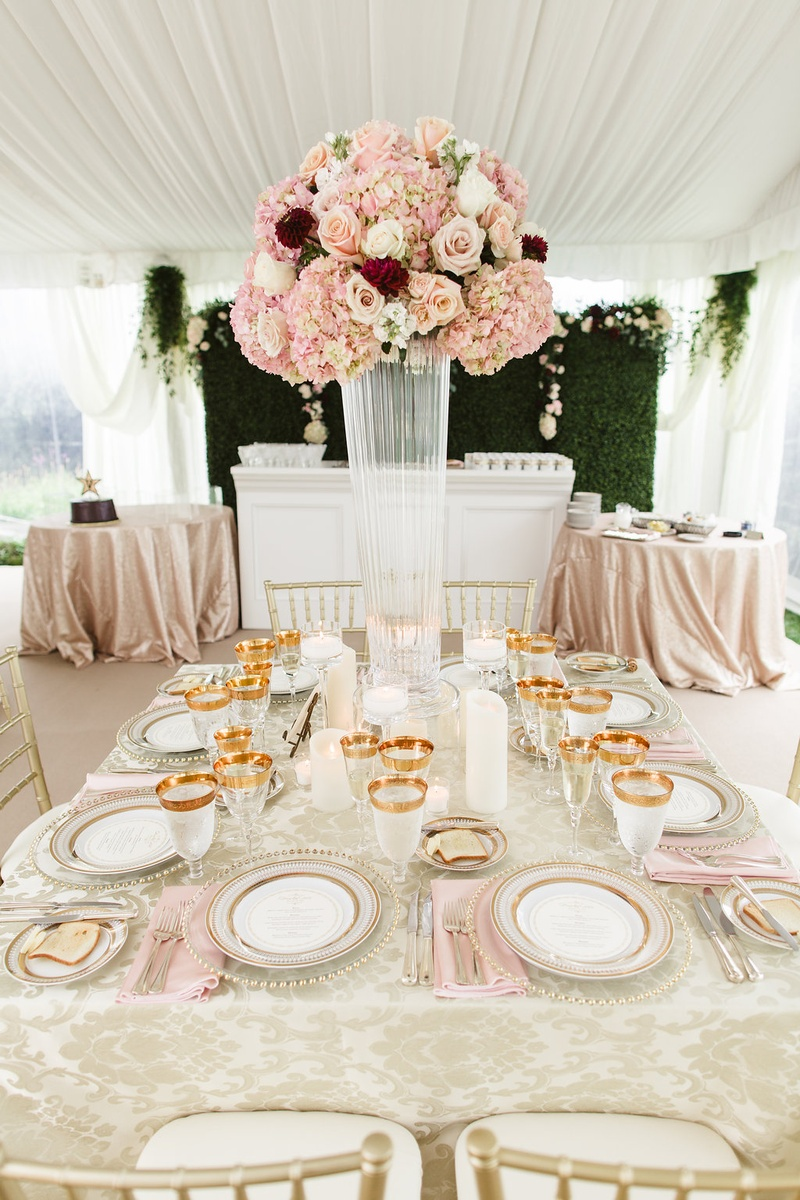 Wedding reception hedge wall square table gold plates glassware pink napkins centerpiece damask