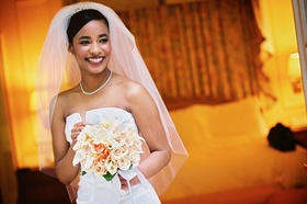 Elbow-length veil with hair up and sparkling necklace