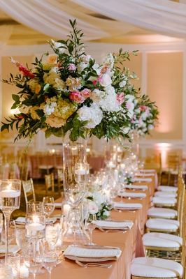 wedding reception long rectangle table blush linen tall centerpiece white pink greenery candless