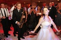 Bride dances in front of jazz sax player at wedding reception