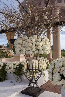 Wedding ceremony decorations white flowers rose hydrangea branches iron stand