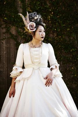 halloween wedding bride white gold dress ruffles pink rose feather hair accessories
