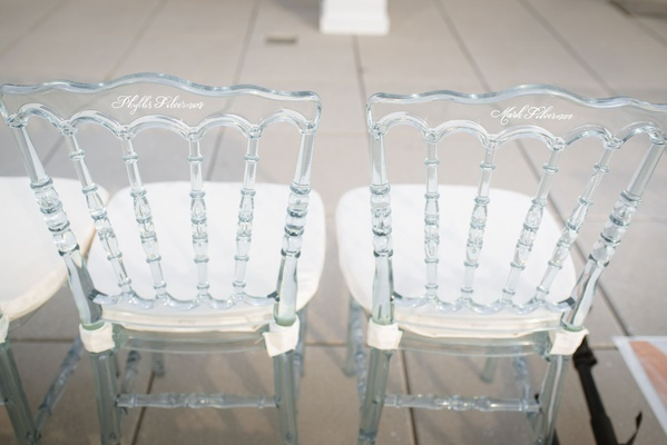 Clear wedding guest ceremony chairs white cushions with white calligraphy names written on back