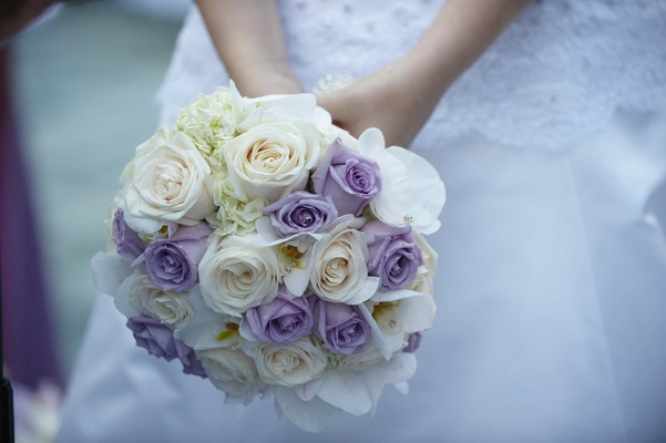 Wedding bouquet flowers purple and white roses