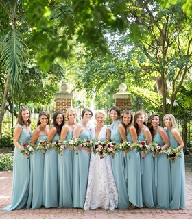 Bride in white dress and bridesmaids in blue with fall theme bouquets key west wedding