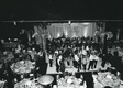 Black and white image of wedding guests on dance floor