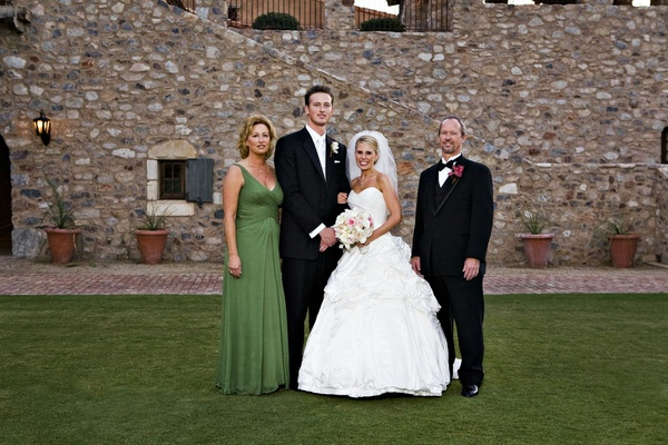 Bride and groom with father of groom and mother of groom