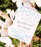 shades of blue text on ceremony program polka dots, romantic quote