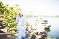 30s-inspired pale bluebridal jacket with lace-trimmed hood, blue ombre skirt