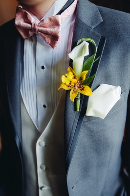 Groomsman in three-piece suit with flowers and pocket square