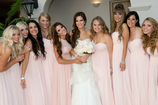 Bride with bridesmaids in pink chiffon gowns