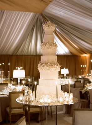 White wedding cake with sugar flowers and damask print