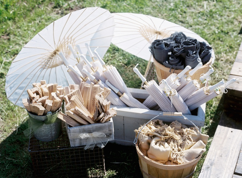 Wood fans and white parasols in crates and boxes