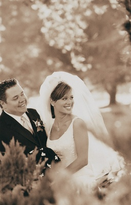 Sepia tone image of couple in forest