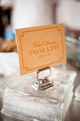 Orange fried green tomato stack sign at wedding