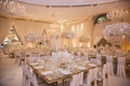square mirrored table with gold rim and tapered candles in candelabra