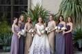 bride in purple floral romona keveža wedding dress, bridesmaids in mismatched purple and champagne