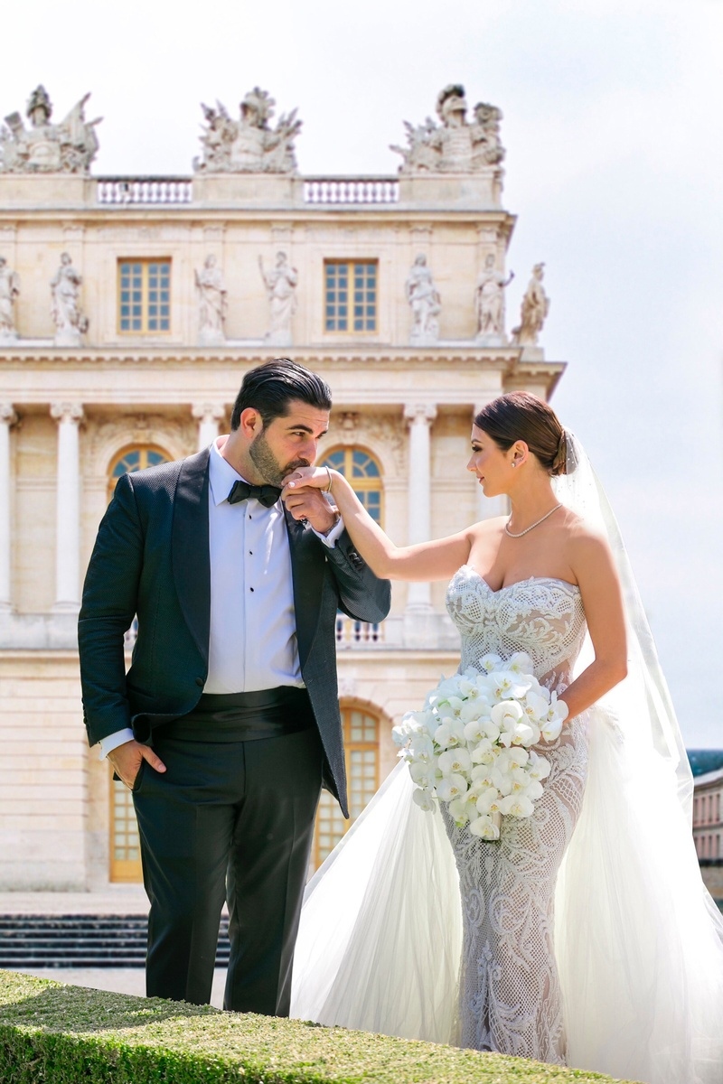 armenian couple, groom kisses bride on hand, bride in leah da gloria lace wedding dress tulle