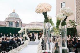 White flowers and calla lilies in vases at angle at entrance to ceremony beverly hills outdoor