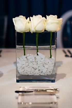White single roses in rectangular vase