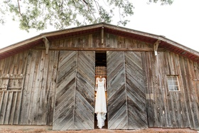 Wedding venue barn vintage with wedding dress hanging up on doors