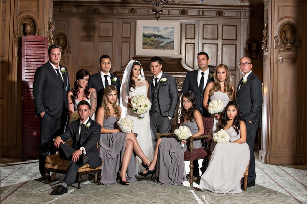bridesmaids wear gray dresses and groomsmen wear black suits