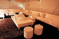Relaxing lounge space with comfortable white seating