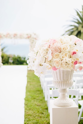 Wedding ceremony bluff ocean view pink white flowers pink rose white rose orchids