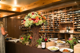 Buffet lunch in wine room with tree branch centerpiece
