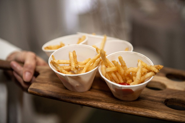 wedding reception late night snack french fries with ketchup in white cones wood tray passed idea