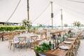 backyard tented wedding reception, garland runner with lanterns