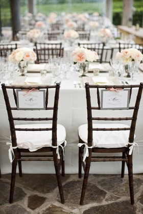 Mr. and Mrs. chair decor at sweetheart table