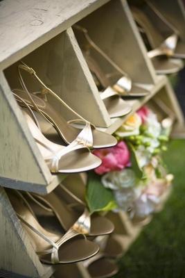 Metallic bridesmaid heels in wooden cubby