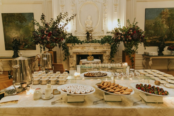 wedding dessert table at rosecliff mansion newport rhode island ballroom cookies chocolate berries