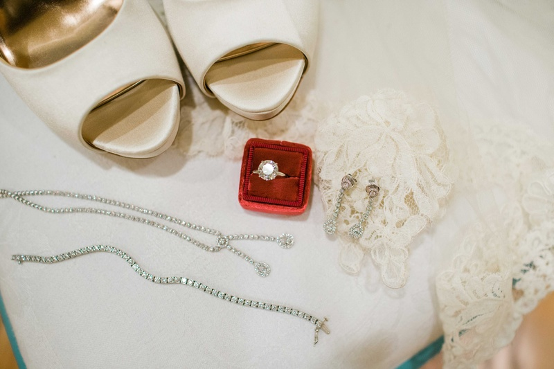 white high heeled shoes white lace red ring box silver jewelry ring bracelets earrings necklace