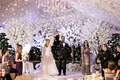 bride and groom husband and wife hands raised white confetti canon white cherry blossom trees