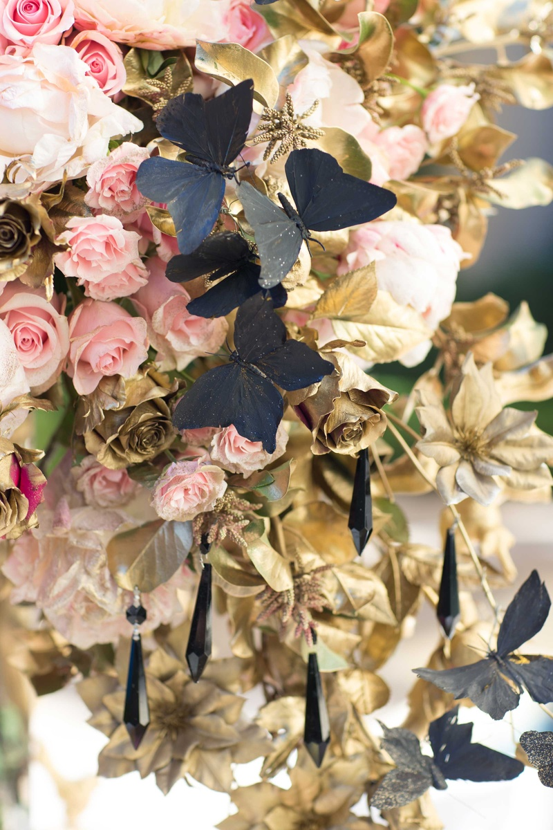 large floral centerpiece alexander mcqueen chanel pink roses black butterflies hanging jewels