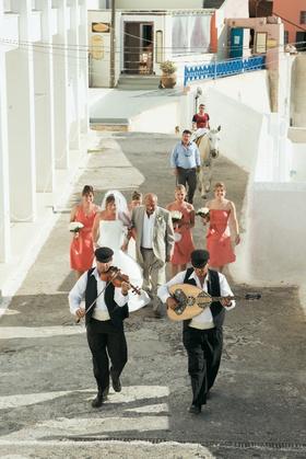 Traditional walk to ceremony in Santorini, Greece