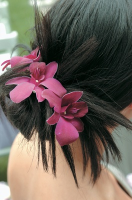 Bridesmaid bun with three pink and purple orchids in hair