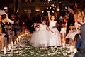 flower girls with tulle dresses, evening ceremony, candlelit aisle dark night Jewish wedding